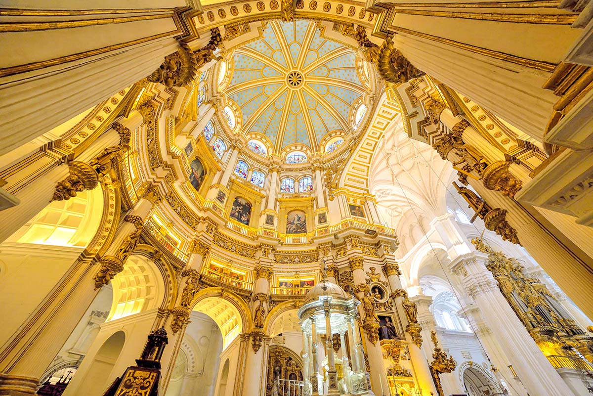 Wide perspective over a cathedral ceiling architecture decorated with marble and glass, in Malaga